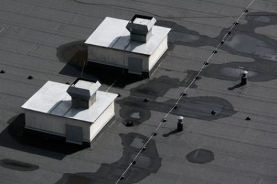 Royal Oak Flat Roof Contractor Discusses Repairs vs Replacements